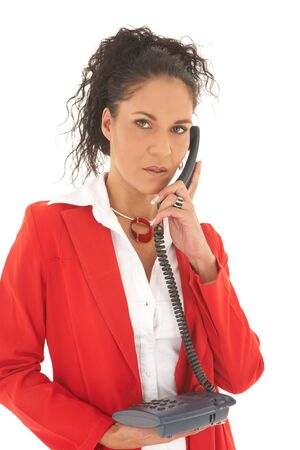 Young adult Caucasian businesswoman wearing a red suit with long brown hair with a blue telephone. NOT ISOLATED photo