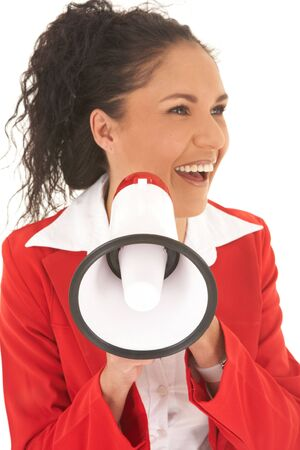 Young adult Caucasian businesswoman wearing a red suit with long brown hair, speaking through a megaphone. NOT ISOLATED  photo