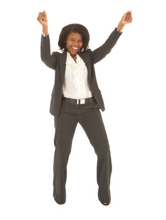 Sexy young adult african businesswoman in a business suit on a white , dancing. NOT ISOLATED Stock Photo