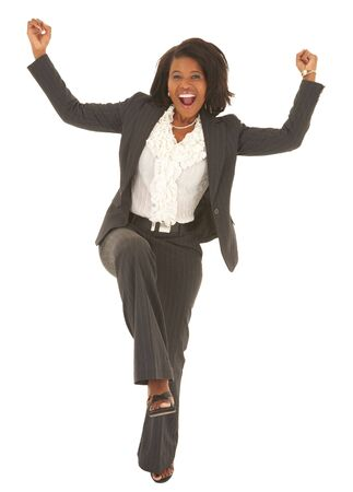 Sexy young adult african businesswoman in a business suit on a white , dancing. NOT ISOLATED photo