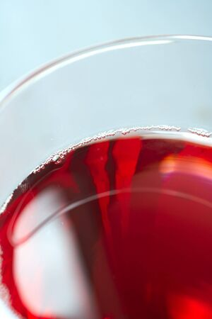 Glass of freshly poured red wine Stock Photo - 4187918