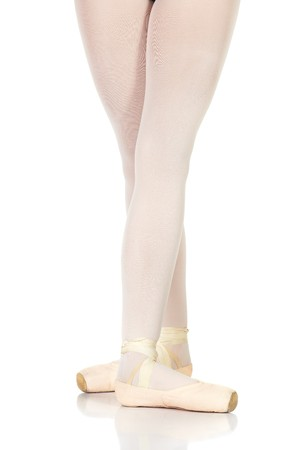 en pointe: Young caucasian ballerina girl on white background and reflective white floor showing various ballet steps and positions. Battement Fondu en Pointe. Not Isolated.