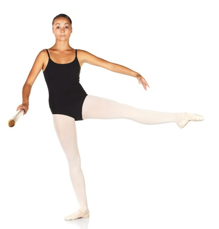 ballet bar: Young caucasian ballerina girl on white background and reflective white floor showing various ballet steps and positions. Develope a la seconde. Not Isolated.