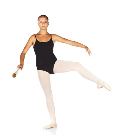 ballet bar: Young caucasian ballerina girl on white background and reflective white floor showing various ballet steps and positions. Retire. Not Isolated. Stock Photo
