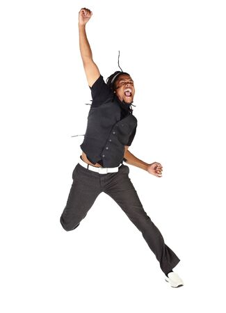 Handsome African businessman in black suit jumping from joy on white background. Not isolated photo