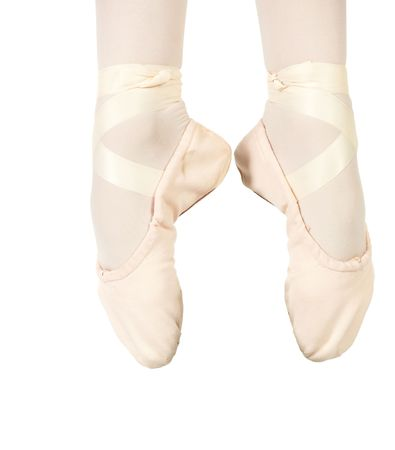 Young female ballet dancer showing various classic ballet feet positions on a white background - Saunte in 1st. NOT ISOLATED photo