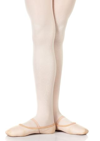 Young female ballet dancer showing various classic ballet feet positions on a white background - 3rd position. NOT ISOLATED Stock Photo
