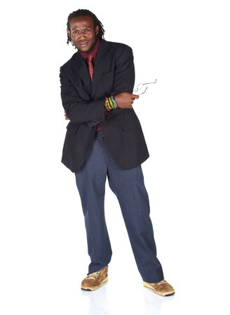Handsome African businessman with glasses in black suit on white background. Not isolated photo