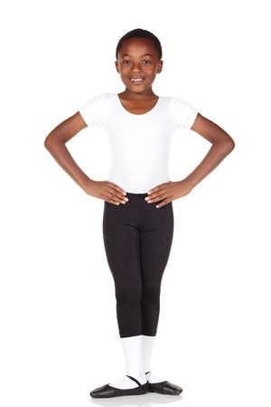 hosiery: Young African ballet boy on white background and reflective white floor showing various ballet steps and positions. Not Isolated