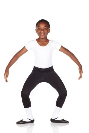 ballet child: Young African ballet boy on white background and reflective white floor showing various ballet steps and positions. Not Isolated