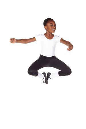 ballet shoes: Young African ballet boy on white background and floor showing various ballet steps and positions. Not Isolated