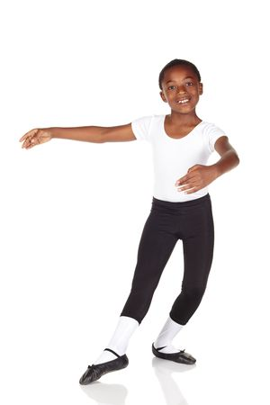 ballet slippers: Young African ballet boy on white background and reflective white floor showing various ballet steps and positions. Not Isolated