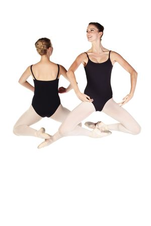 Young caucasian ballerinas on white background and reflective white floor showing various ballet steps and positions. Not Isolated photo