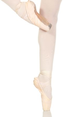 Young caucasian ballerina girl on white background and reflective white floor showing various ballet steps and positions. Not Isolated photo