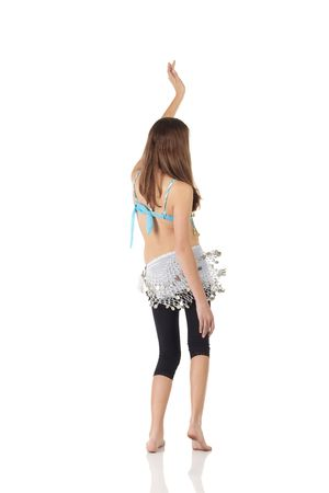 bellydance: Young Caucasian belly dancing girl in beautiful decorated clothes on white background and reflective floor. Not isolated Stock Photo