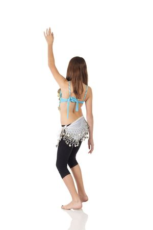 Young Caucasian belly dancing girl in beautiful decorated clothes on white background and reflective floor. Not isolated Stock Photo - 5275140