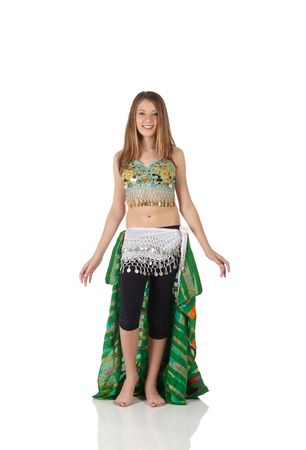 belly dancing: Young Caucasian belly dancing girl in beautiful decorated clothes on white background and reflective floor. Not isolated Stock Photo
