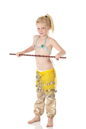 Young Caucasian belly dancing girl in beautiful decorated clothes on white background and reflective floor. Not isolated photo