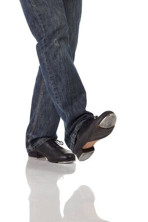 tap dance: Single male tap dancer wearing jeans showing various steps in studio with white background and reflective floor. Not isolated