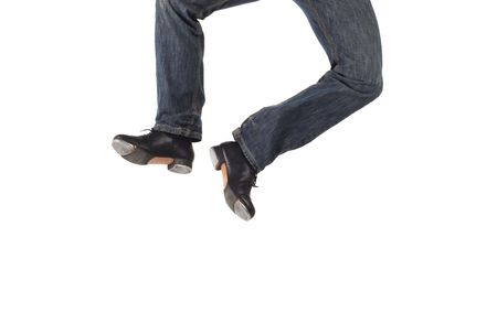 tap dance: Single male tap dancer wearing jeans showing various steps in studio with white background. Not isolated