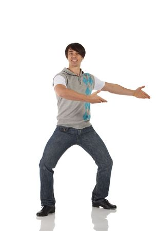tap dance: Single Caucasian male tap dancer wearing jeans showing various steps in studio with white background and reflective floor. Not isolated
