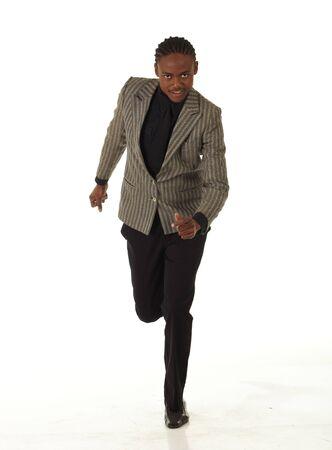 no correr: Empresario Negro Africana sobre un fondo blanco en varias posiciones, posturas y con diferentes expresiones faciales. Parte de una serie - no aislado