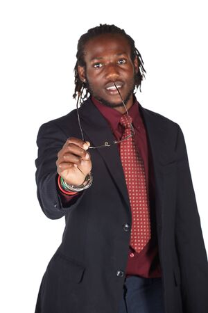 Handsome African businessman in colorful suit holding his glasses on white background. NOT ISOLATED photo