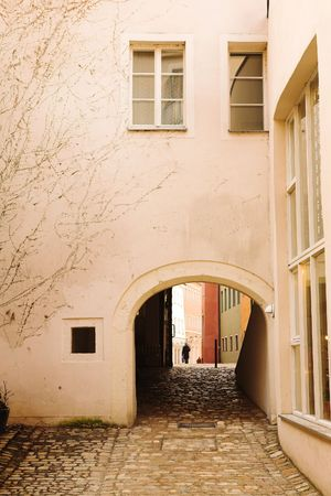 regensburg: Buildings with windows and cobblestone walkway in Regensburg, Germany