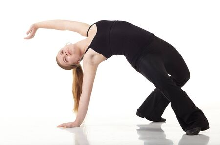 jazz dance: Young caucasian Modern Jazz dancer in a black top and black pants on a white background displaying various positions. NOT ISOLATED
