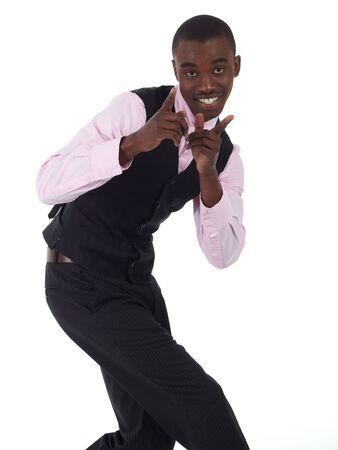 gezichts uitdrukkingen: Young Adult zwarte Afrikaanse zaken man het dragen van een donkere smart-casual outfit zonder een jas, maar met een roze shirt en een donkere vest op een witte achtergrond in verschillende poses met verschillende gezichtsuitdrukkingen. Deel van een serie, niet geïsoleerd. Stockfoto