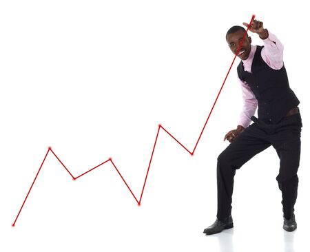 Red graph drawn with his finger by a happy businessman pointing up at the highest point. photo