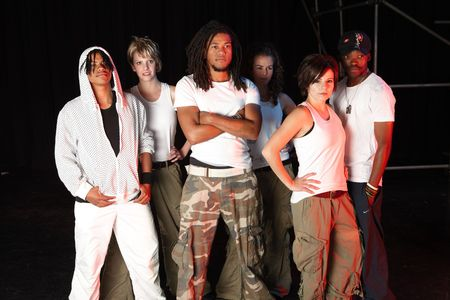 A group of six female and male freestyle hip-hop dancers. Lit with spotlights photo