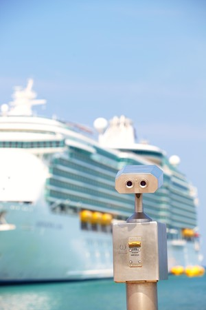 A metallic coin operated viewer for tourists to look at the white holiday cruise liners in the port of Kusadasi, Turkey, on the Aegean Coast Stock Photo - 7021811