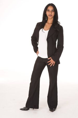 Young adult African-Indian businesswoman in casual office outfit with black pants and high heels with a dark jacket on a white background. Not Isolated Stock Photo - 7430870