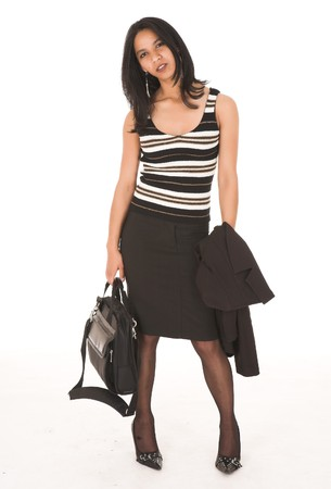 pencil skirt: Young adult African-Indian businesswoman in casual office outfit with a black pencil skirt, a striped brown top and high heels with a briefcase on a white background. Not Isolated  Stock Photo