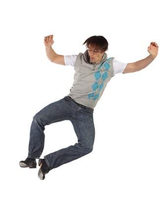 rubinetti: Unico adulto maschio rubinetto ballerino indossa jeans mostra i vari passaggi in studio con sfondo bianco e piano riflettente. Non isolata