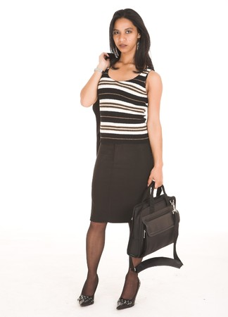 pencil skirt: Young adult African-Indian businesswoman in casual office outfit with a black pencil skirt, a striped brown top and high heels with a briefcase on a white background. Not Isolated