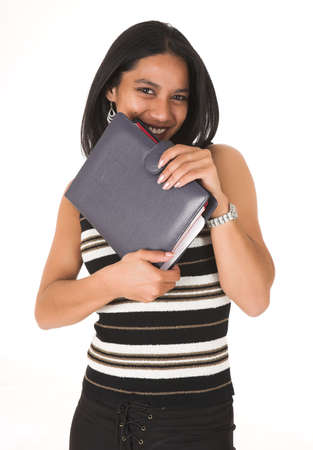 hidden success: Young adult African-Indian businesswoman in casual office outfit with a daybook, wearing striped top on a white background. Not Isolated