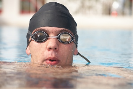 Healthy young adult male aquatic athlete. Professional swimmer in blue water Stock Photo - 8239586