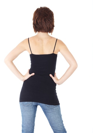 Cute young adult caucasian woman wearing a black top and jeans and with short brunette hair on a white background. Not Isolated photo