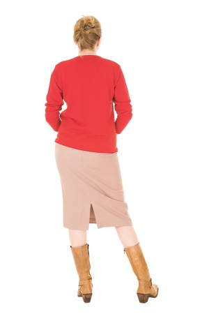 Sexy young adult Caucasian businesswoman in Red top and pencil skirt on a white background. NOT ISOLATED photo