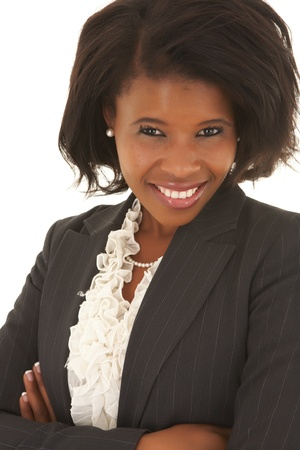 Young adult Caucasian businesswoman wearing a grey suit with curly brown hair on a white background. NOT ISOLATED photo