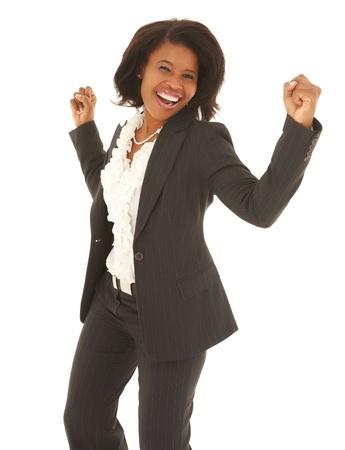 gente bailando: Adulto joven empresaria caucásica vestido con un traje gris con el pelo rizado marrón sobre un fondo blanco. NO AISLADO Foto de archivo