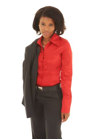 Young adult Caucasian businesswoman wearing a grey suit with a red shirt and curly brown hair on a white background. NOT ISOLATED photo