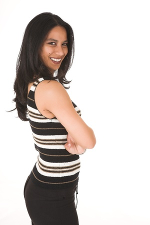 average woman: Young adult African-Indian businesswoman in casual office outfit with black pants, a striped top and high heels on a white background. Not Isolated