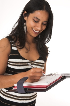 Young adult African-Indian businesswoman in casual office outfit with a daybook, wearing striped top on a white background. Not Isolated photo