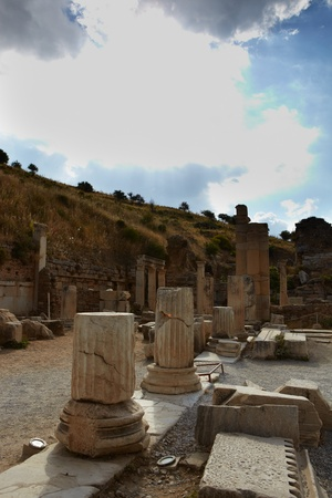 Pillars and collumns next to the main road in the old ruins of the city of Ephesus in modern day Turkey Stock Photo - 11706080