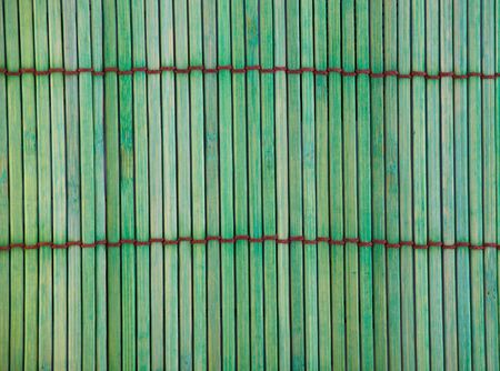 Rough textured green bamboo placemat with brown stitching. Stock Photo - 11706105