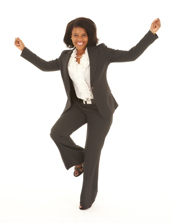 Young adult Caucasian businesswoman wearing a grey suit with curly brown hair on a white background  NOT ISOLATED Stock Photo