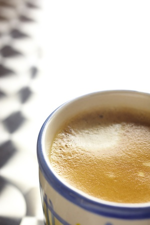 Creamy coffee cup on a a stainless steel table  Shallow Depth of Field, focus on the foam of the cup Stock Photo - 13644553